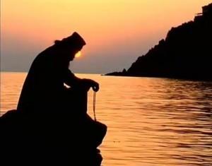 monk-praying-sunset-...-300x235